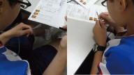 lanケーブル製作に集中している中学生を2つの角度から写している写真